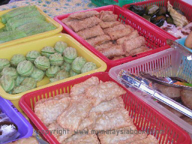A variety of kueh sold at stalls.
