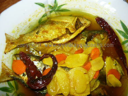 Acar Ikan (pickled fish) – fried fish soaked in a light gravy cooked ...