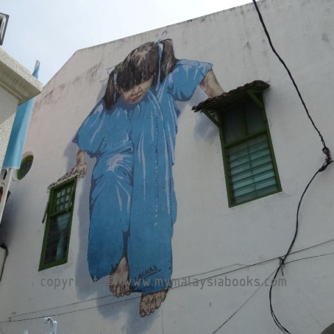 Little girl in blue - Street Art by Ernest Zacharevic (mypenang.my)