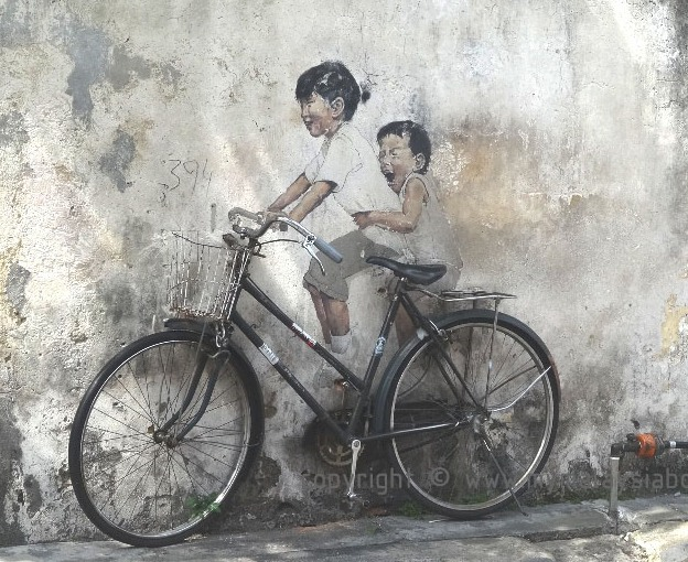 Little Children on Bicycle by Street Art by Ernest Zacharevic (mypenang.my)